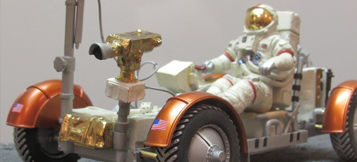 NASA Replicas of Astronaut in orange Moon Vehicle on Loan for Fall Exhibit