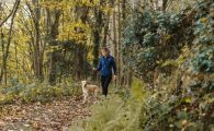 girl and dog hiking on trail