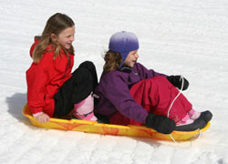 girls_sledding